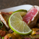 Reminiscent of a night on the beach in Negril. Jerked wild caught Tuna with garden fresh vegetables, - Negril Nights at Nine Mile