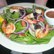 Spinach Salad Topped with Onion, Tomoato, Chopped Egg and Bacon Bits added shrimp for $2.00 extra at DuckTales Kitchen