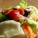 Fresh crisp salad. Great price and sered with choice of Italian, Ranch, Blue Cheese - House Salad at Amore New York Pizzeria
