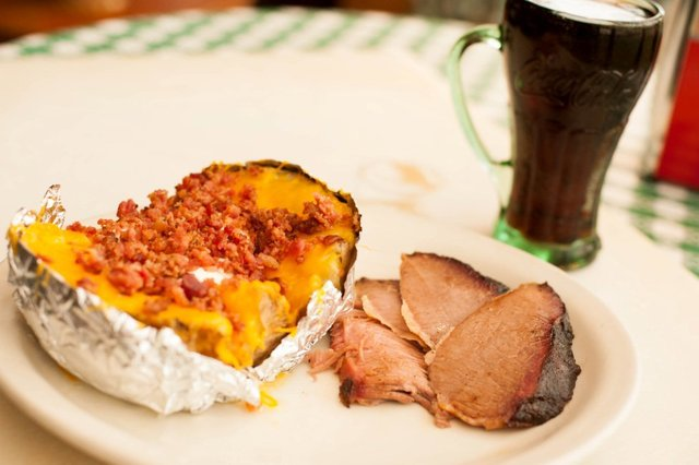 Stuffed Baked Potato with Sliced Brisket at Cokers Barbecue