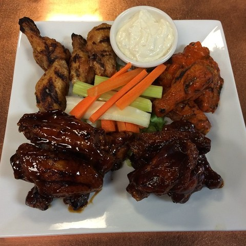 Amazingly crisp on the outside while tender and juicy inside - Fried & Grilled Wings at The Regal Beagle