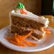 A traditional no-nut carrot cake made with a pound of carrots finished with a cream cheese cardamon  - 14kt. Carrot Cake at Nine Mile