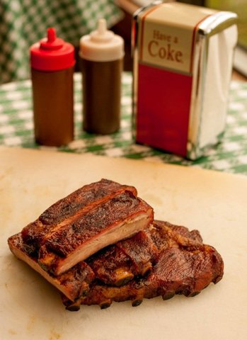 Side view of ribs. Our Best Ribs in Texas do not need any sauce at all, but we do offer our origin - More ribs at Cokers Barbecue