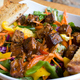 Mixed greens with your choice of Jerk chicken or tofu. Topped with carrots, purple cabbage and rasta - Livity at Nine Mile